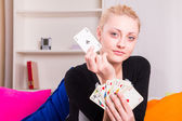 Woman playing cards — Stock Photo