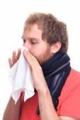 Sick man using  handkerchief — Stock Photo