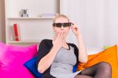 Woman watching movie in 3D glasses — Stock Photo