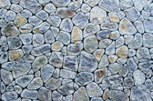 Beautiful wall from multicolored stone — Foto Stock