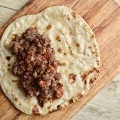 Mexican cuisine. Fried tortilla with meat. — Stock Photo