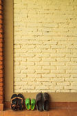 Shoes against the wall — Stock Photo
