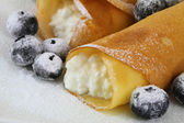 Crepes with cottage cheese and blueberries — Stock Photo