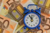 Time is money concept, miniature clock on banknotes — Stock Photo