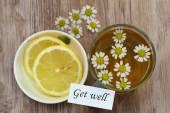 Get well note, chamomile tea and fresh lemon — Stock Photo