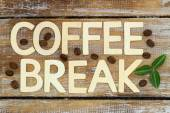 Coffee break written with wooden letters on rustic wooden surface — Stock Photo