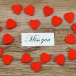 Miss you card with little red wooden hearts — Stock Photo #55863055