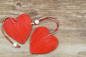 Two red wooden hearts on wooden surface with copy space — Stock Photo