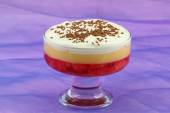 Strawberry trifle in sundae glass on purple background — Stock Photo