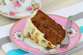 Carrot and walnut cake with marzipan icing, close up — Stock Photo