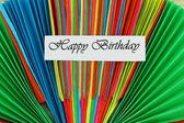 Happy Birthday card on colorful rainbow fan — Stock Photo