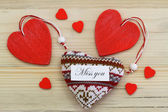 Miss  you card with red wooden and knitted hearts — Stock Photo