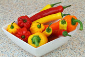 Bowl full of peppers and chili peppers — Stock Photo