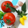 Cherry tomatoes with selection of fresh herbs and mixed peppers — Stock Photo #58066143