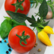 Cherry tomatoes with selection of fresh herbs and mixed peppers — Stock Photo #58066865
