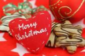 Merry Christmas on canvas heart — Stock Photo
