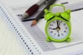 Miniature clock on open agenda — Stock Photo