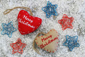 Merry Christmas card with canvas hearts — Stock Photo