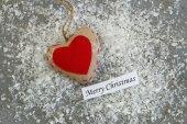 Merry Christmas heart on snowy surface — Stock Photo