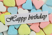 Happy Birthday card with colorful candy hearts — Stock Photo