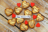 Happy Valentine's day with heart shaped cookies with chocolate — Stock Photo