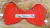 Happy Valentine's Day with two red wooden hearts — Stockfoto