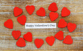 Happy Valentine's Day with little red wooden hearts — Φωτογραφία Αρχείου