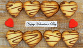 Happy Valentine's Day card with heart shaped cookies — Stock Photo
