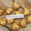 Happy Mother's day card with heart shaped biscuits — Stock Photo #69791051