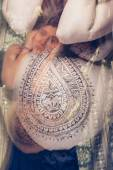 Beautiful pregnant woman with henna pattern on her belly in dramatic pose — Stock Photo