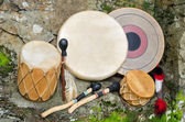 Group of four, Native American Drums, with Drum Sticks. — Photo