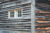 Corner of Weathered Barn Wall with Windows and Rustic Wood Siding. — Stock Photo