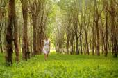 Woman walking in the forest — Stock Photo