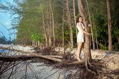 Woman hug a tree on tropical beach — Stock Photo