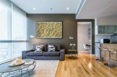 Living room with big window and brown wall interior — Stok fotoğraf