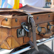 Old style suitcases outdoors — Stock Photo #55771819