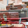 Old style suitcases outdoors — Stock Photo #55771965