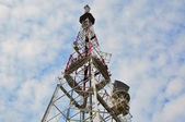 Mobile phone communication repeater antenna tower in blue sky  — Stock Photo