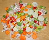 Miscellaneous fresh vegetables cut up in pieces ready for stir f — Stock Photo