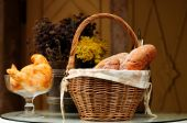 Composition with bread and rolls in wicker basket — Stock Photo