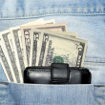 American dollar bills in jeans pocket — Stock Photo #68944331