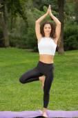 Smiling pretty woman doing yoga exercises — Stock Photo