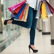 Woman legs with shopping bags — Stock Photo #59599625