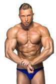 Attractive male body builder on white background — Stock Photo