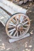 Antique bench made from carriage wheel — ストック写真