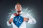 Businessman acting like a super hero and tearing his shirt off — Stock Photo