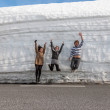 Highway along the snow wall. Norway in spring — Stock Photo #67161319