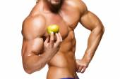 Shaped and healthy body man holding a fresh apple fruit,  isolated on white background — Stock Photo