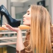 Woman kissing shoe. Women loves shoes concept. — Stock Photo #68940829