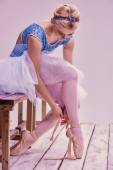 Professional ballerina putting on her ballet shoes. — Stock Photo